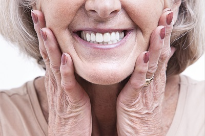 Close up view on senior wearing dentures