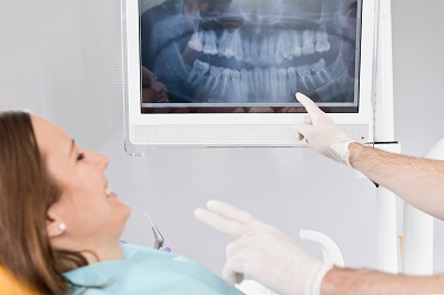 Dentist showing X-ray image to patient