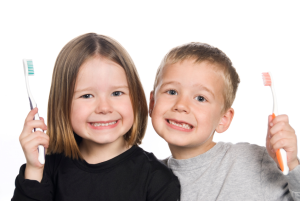 Smiling Children with Toothbrushes-Family Dentistry