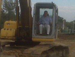 Dentist in large construction machine