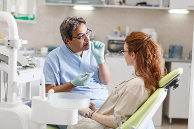 patient discussion treatment options with dental professional