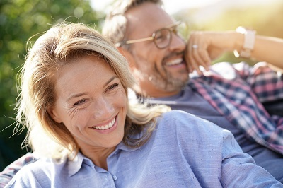 Portrait of mature couple relaxing outdoors