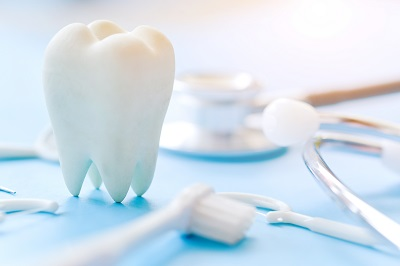 Dental model and dental equipment on blue background