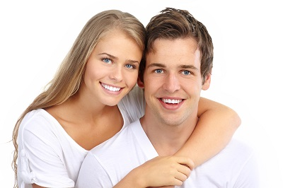 young couple with healthy while smiles