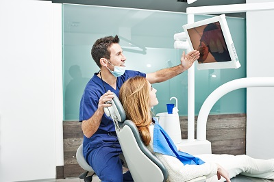 patient in dental chair looking at screen