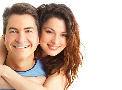 Young couple smiling over white background