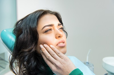 Young female having toothache.