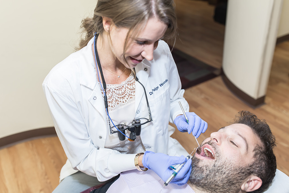 cosmetic dentist Dr. Woods with patient