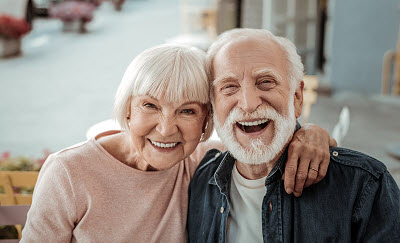 Senior couple smiling at home