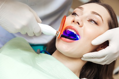 female patient getting in-office teeth whitening