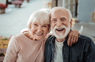 Image of happy senior couple at home