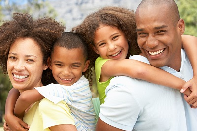 Image of happy African American family at the park