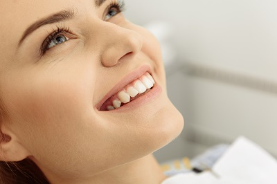 Lovely smile of pretty woman at dental clinic waiting for treatment
