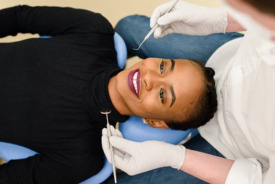 Young African-American woman getting a dental check up