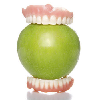 Picture of dentures biting an apple