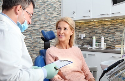 patient consulting with dentist regarding treatment options