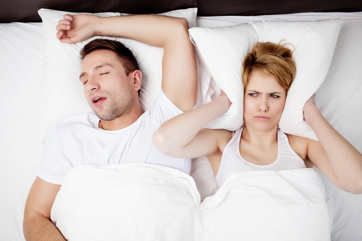 Snoring man with suffering wife | Dentalcare Associates | Scotch Plains, NJ