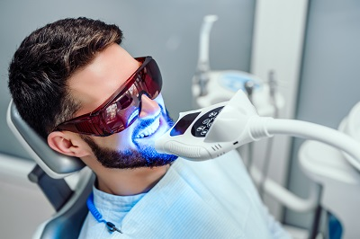 patient getting in-office professional teeth whitening
