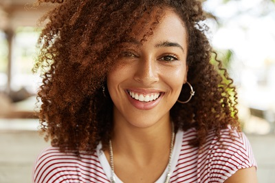 Close up shot of adorable African American woman