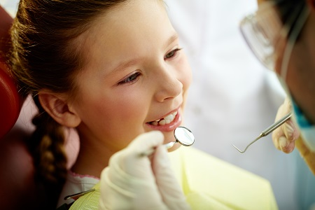 close up of little girl getting a dental checkup