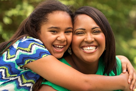 African American mother and daughter with healthy smiles