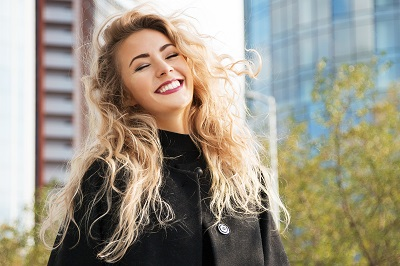 smiling woman with city background