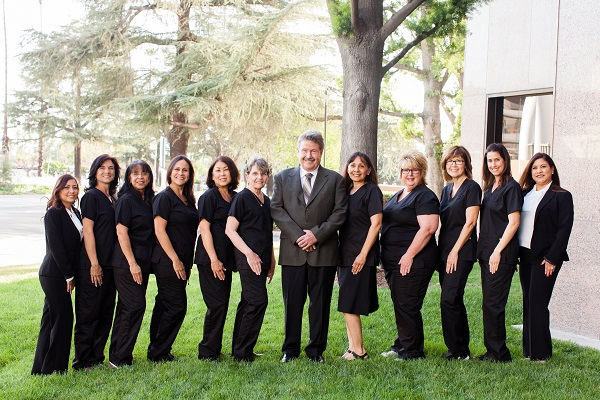 Group Photo of Dr. Jacobsen and dental team outside