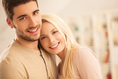 Smiling young couple posing together.