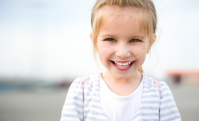 Image of happy little girl smiling