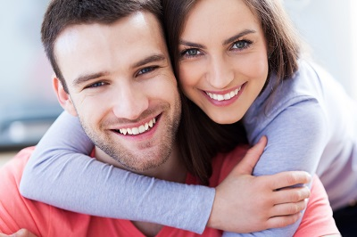 young couple with healthy smile