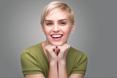 young woman with pixie haircut and perfect smile