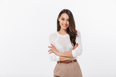 Portrait of a smiling asian businesswoman standing with arms folded