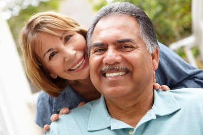 Hispanic senior couple relaxing in garden