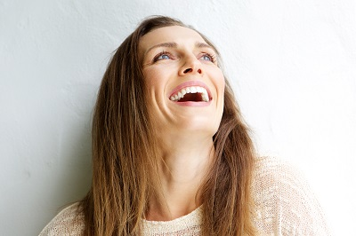 middle aged woman laughing