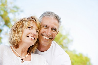 Portrait of a happy mature couple outdoors.