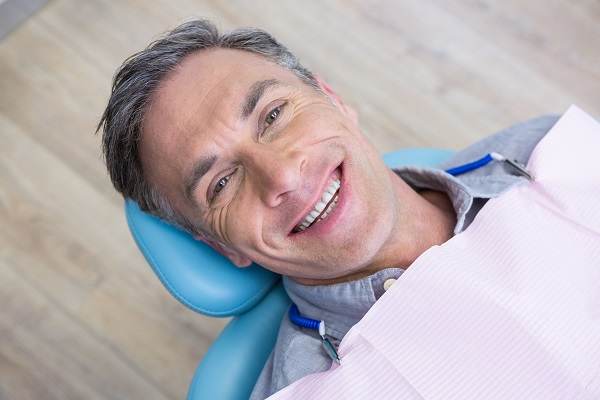 close up of smiling man at dentist