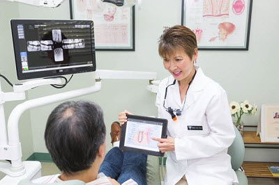 Dr. anna Lee DDS discussing treatment with patient - Glendora, CA Dentist