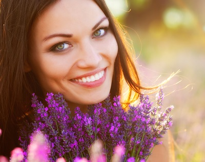 smiling woman with perfect smile on lavender field