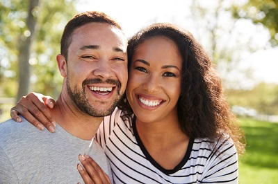 couple smiling in the park