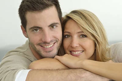 portrait of young couple over grey background