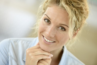 Portrait of beautiful middle-aged blond woman smiling