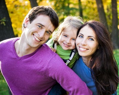Portrait of happy smiling family in autumn park
