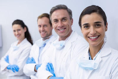 group of dental professionals in dental clinic