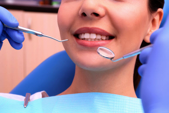 woman getting a professional dental cleaning