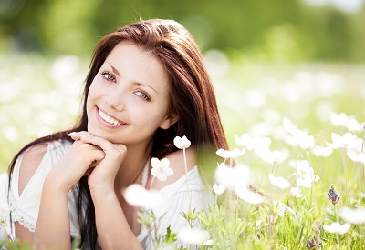 woman with beautiful smile in flower field