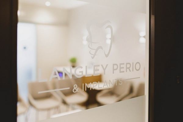 langley perio & implants logo on office door