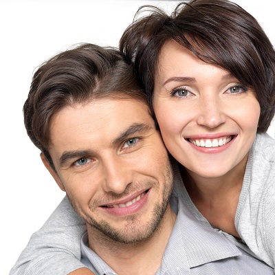 closeup of smiling couple isolated in white background
