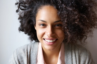 Close up portrait of a beautiful young african american woman smiling