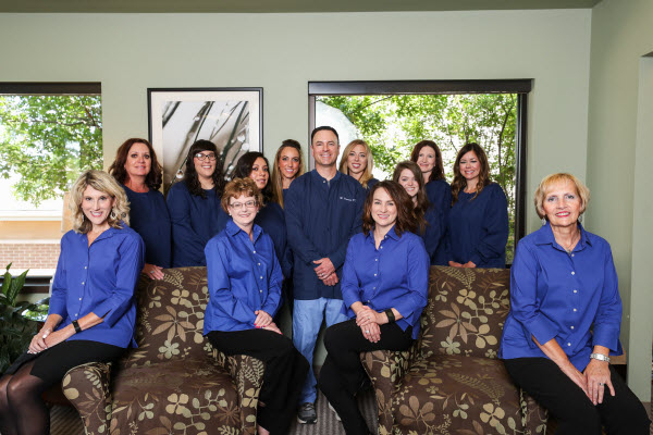 Picture of Dr. Harrison & his dental staff