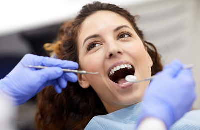 Image of woman getting a dental inspection